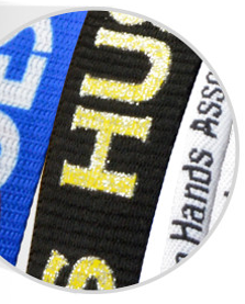 Close up of Brady People ID's custom silkscreen lanyards